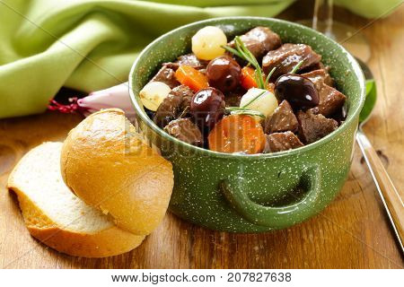 beef stew in red wine with vegetables and herbs