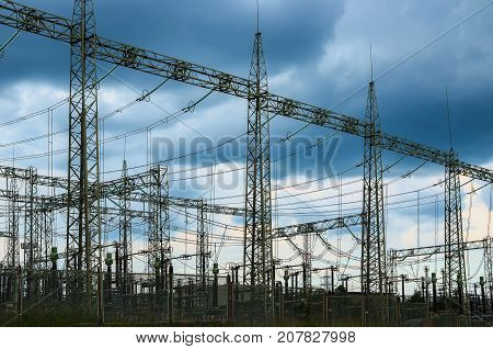 Electricity. Distribution electric substation with power lines and transformers.
