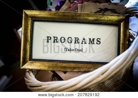 Rustic retro chic or old sign used at a wedding or theater performance to hand out programs.