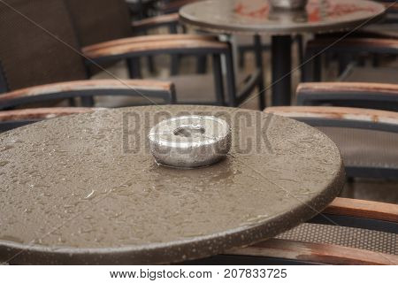 Wet table of a street cafe with ashtray