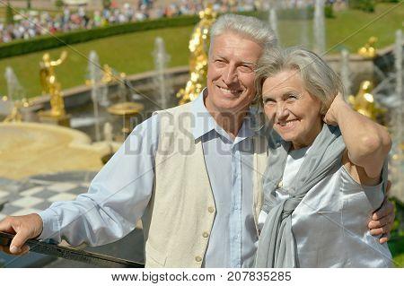 portrait of beautiful caucasian senior couple hugging outdoors