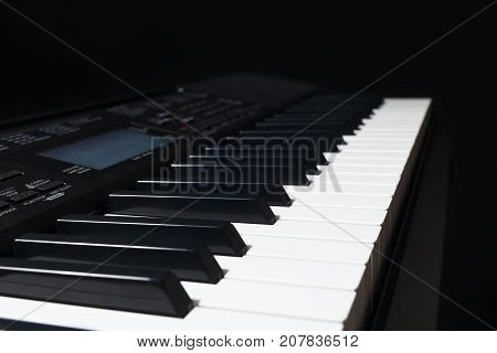 The digital piano on a black background