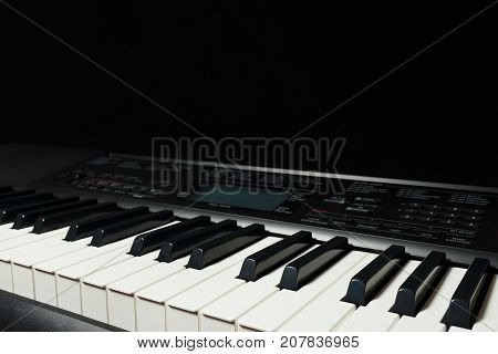 Keys of the digital piano on a black background