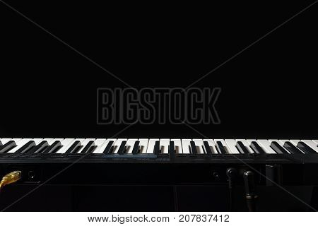 Keyboard of the digital organ on a black background