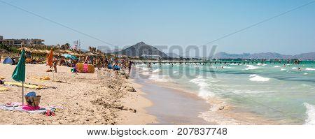 Alcudia, Majorca, Balearic islands, July 2017: Playa de Muro beach in summer peak season near Albufera resorts