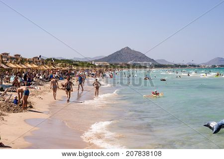Alcudia, Majorca, Balearic islands, July 2017: Tourists at Playa de Muro beach in summer peak season near Albufera resorts