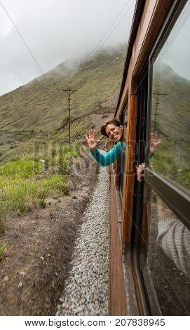 Woman Waves From Train Window