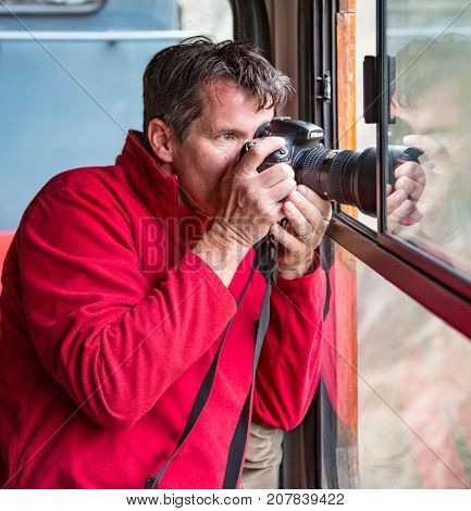 Man Photographs Out Train Window
