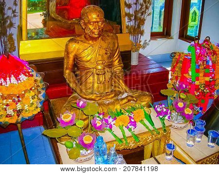 Koh Samui, Thailand - June 20 2008: Golden Buddha statue in Temple on Koh Samui in Thailand on June 21, 2008: