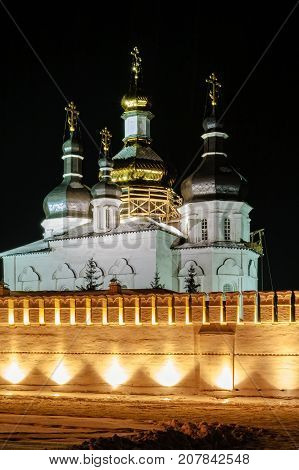 Tyumen Russia - January 15 2005: Holy Trinity Monastery. Church of Saints Peter and Paul and Holy Trinity Cathedral. Restoration. Twilight time