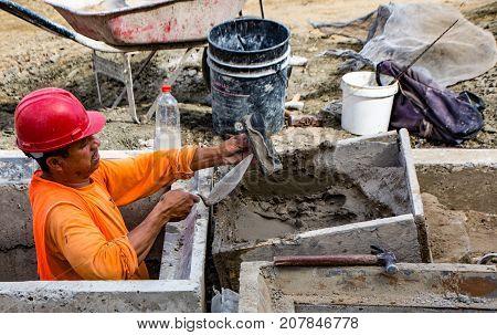 Man Trowels Mortor For Road Construction