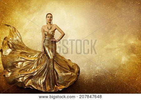 Golden Fashion Model Elegant Woman Flying Gold Dress Waving Sparkling Gown Fabric