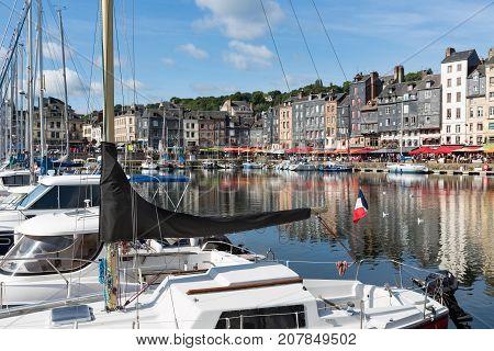 Saling boats in old medieval harbor of Honfleur France
