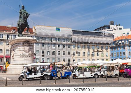 Tuk Tuk Taxi Cabs Of Lisbon Stand On Square