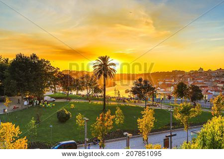 Aerial view of Jardim do Morro, a little public park, in Avenida da Republica from Serra do Pilar at Vila Nova de Gaia, Porto in Portugal. Picturesque urban cityscape at sunset light.