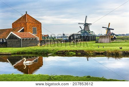 Wooden Windmills Zaanse Schans Old Windmill Village White Swan Countryside Holland Netherlands. Working windmills from the 16th to 18th century on the River Zaan.