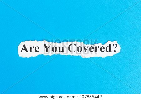 Are You Covered text on paper. Word Are You Covered on torn paper. Concept Image.