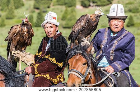 Eagle Hunters Hold Their Eagles, Ready For Action