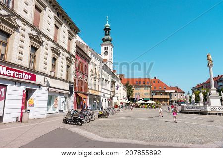 MARIBOR, SLOVENIA - AUGUST 24, 2017: Main square and plague column at Main Square of the city of Maribor in Slovenia, Europe. Historical religious sculpture