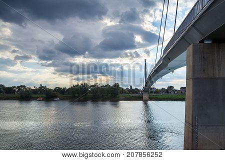 Saint Irinej bridge (Most Svetog Irineja) corring the Sava river in Sremska Mitrovica (Serbia) taken during an end of afternoon in autumn. Sremska Mitrovica is one of the main cities of the northern Serbian Region of Srem