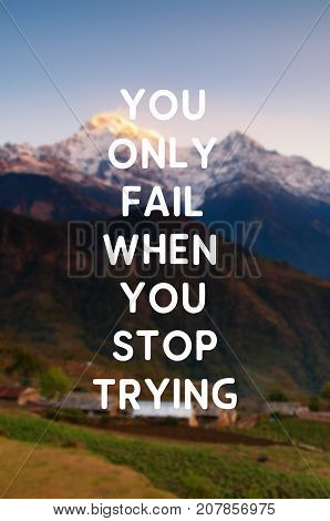 Inspirational and motivational quotes - You only fail when you stop trying. Blurry retro style background.