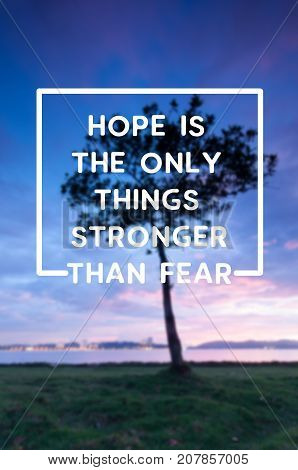 Inspirational and motivational quotes - Hope is the only things stronger than fear. Blurry retro style background.