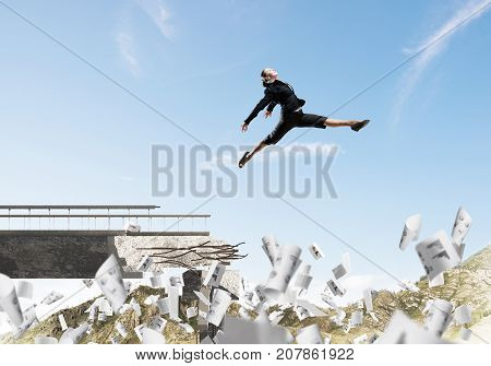 Business woman jumping over gap in bridge among flying papers as symbol of overcoming challenges. Skyscape and nature view on background. 3D rendering.