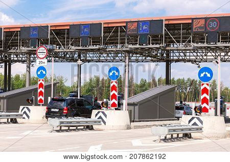 Moscow Russia - July 16 2017: Cars passing through the automatic point of payment on a toll road. Russian highway number M11