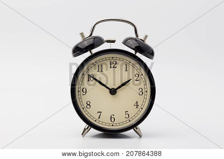 black alarm clock on white background, happy clock