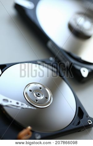 Hard drive from computer or laptop lies on the table in the repair shop. Performs fault diagnostics and performs urgent repairs recovery of lost data during deletion HDD closeup
