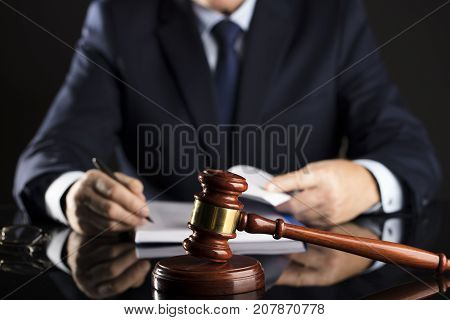 Man signing documents. Gavel. Law and attorney concept.