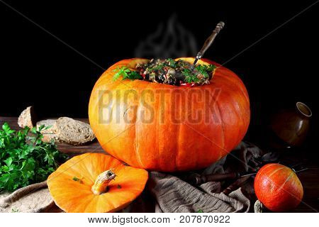 hot vegetable stew with parsley in a pumpkin
