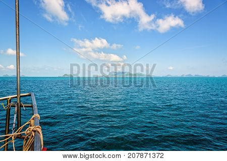 Prow of the boat on the beautiful sea under bright blue sky in summer overlooking the horizon is traveling to Mu Ko Ang Thong National Marine Park Surat Thani province Thailand.