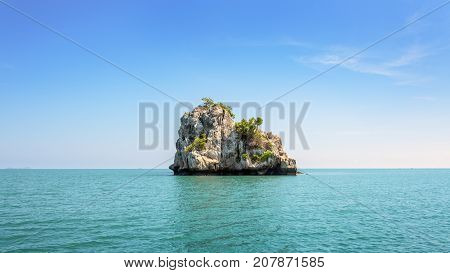 Beautiful natural landscape of small island on the sea under bright blue sky in summer at Mu Ko Ang Thong National Marine Park is a attractions in Surat Thani Thailand 16:9 widescreen