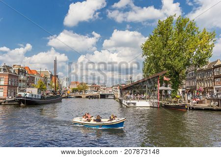 LEIDEN, NETHERLANDS - SEPTEMBER 03, 2017: Small boat in the central canals of Leiden Holland