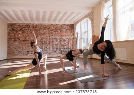 Ballerinas exercise rehearsal. Sport for girls. Rhythmic gymnastics in dance class with female coach. Gym background, healthy lifestyle, individuality concept