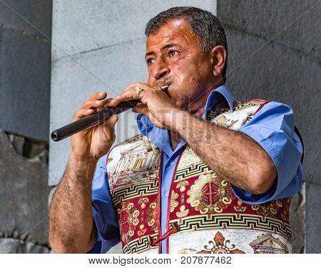 Man Plays Traditional Duduk Instrument