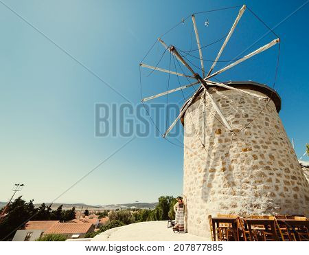 Girl near old windmills. Summer holidays in europe,vacation,traveler.Spain,greece,turkey.