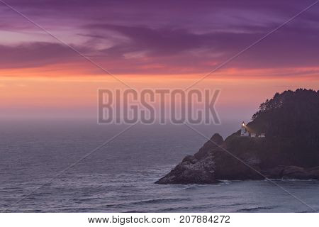 Purple Sunset Over Heceta Head Lighthouse along Oregon coast