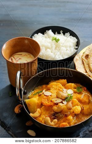 Vegetable or Navratan Korma - Indian Mixed Veg Curry served with Roti and rice