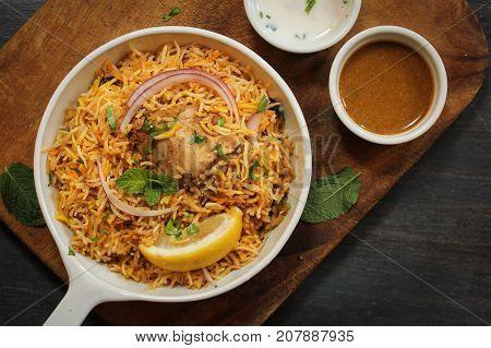 Hyderabadi Chicken Biryani served with Yogurt raita and Salan