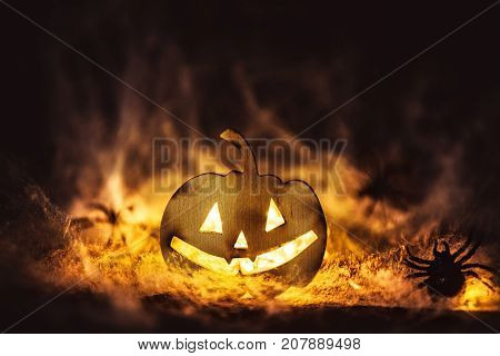Halloween pumpkin grinning face mysteryspiders on web