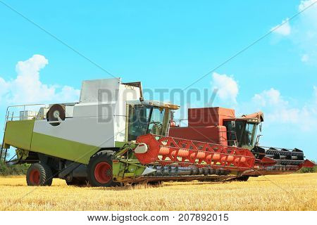 Two combine harvesters in field