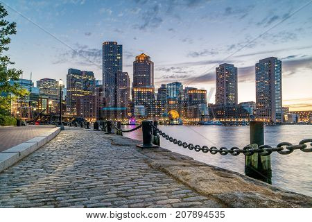 Boston Harbor and Financial District view from harbor on downtown cityscape at sunset Massachusetts USA horizontal