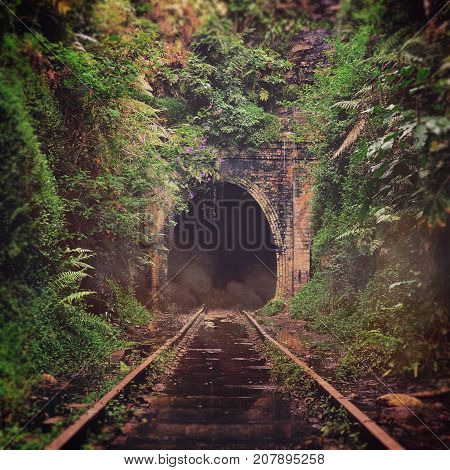 Spooky misty entrance to an abandoned historic railway tunnel in Helensburgh, New South Wales, Australia