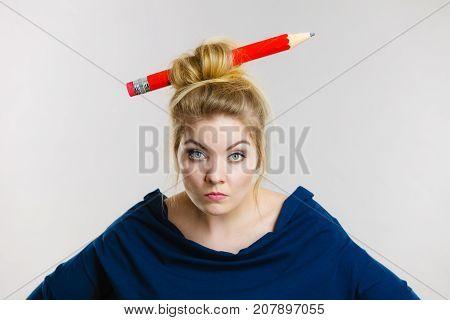 Bored Blonde Woman Having Big Pencil In Hair
