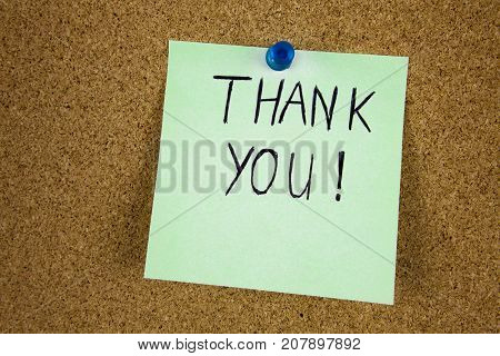 Writing Thank you on the sticky post note businnes concept