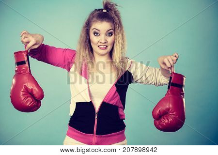 Disgusted Woman Holding Boxing Glove
