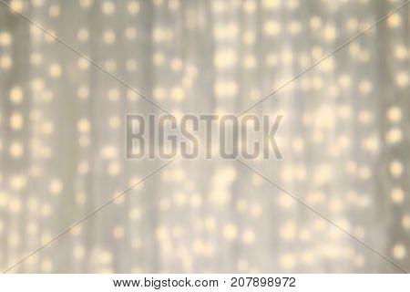 LED light on white cloth curtain backdrop. Defocus white light Background.