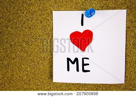 I love me reminder note - handwriting in black ink on an on cork board background. Businnes concept